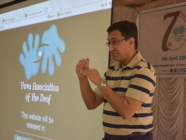 Aqil Chinoy giving lecture at Yuva Association of the Deaf